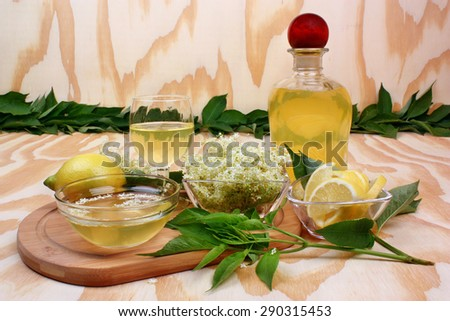 Syrup of flowers elderberry on wooden background