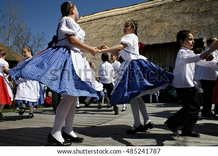 SZENTENDRE, HUNGARY - APRIL 08: unidentified children dance in traditional dress at the Easter Festival on April 08, 2007 in Szentendre, Hungary