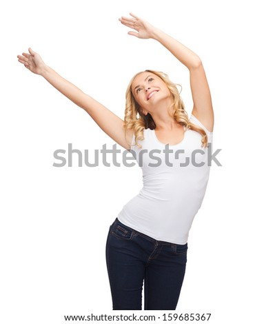 t-shirt design, harmony, happiness concept - happy dancing woman with raised hands in blank white t-shirt