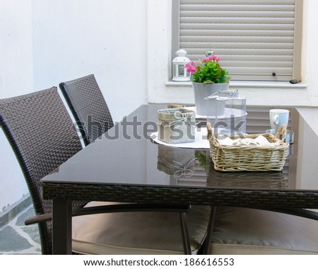 Table and chairs set for breakfast  on terrace