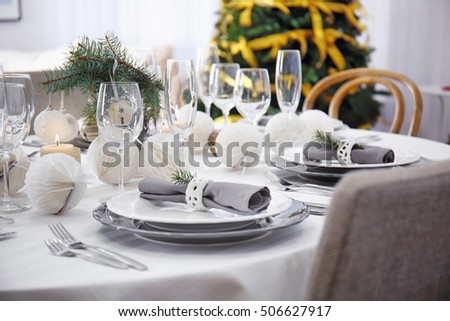 Table served for Christmas dinner in living room, close up view