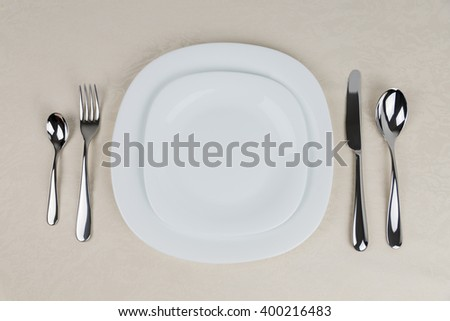Table Setting/ A set of dishes and cutlery provided for one person at a meal