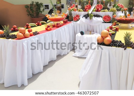 Table with variety of colorful food fruits and drinks