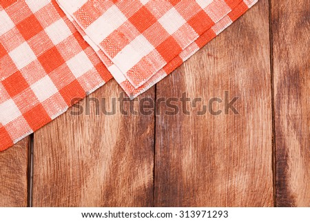 Tablecloth red and white checkered wavy on wooden table