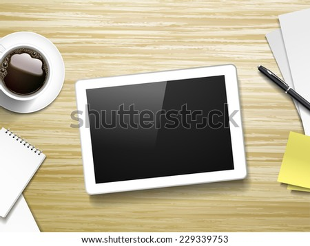 tablet and working place elements over wooden table