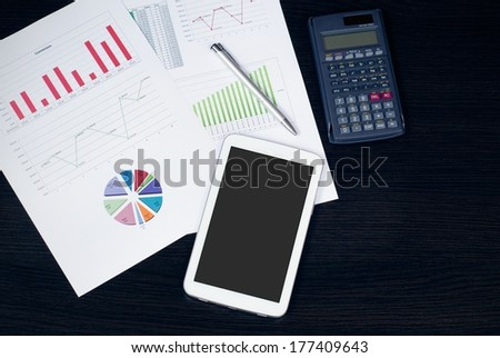 Tablet in office, business composition on desk top view