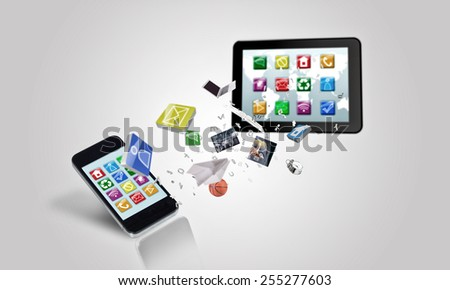 Tablet pc and mobile smartphone and icons on white background