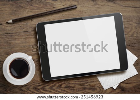 Tablet pc like ipad on table desk with coffee cup and pencil