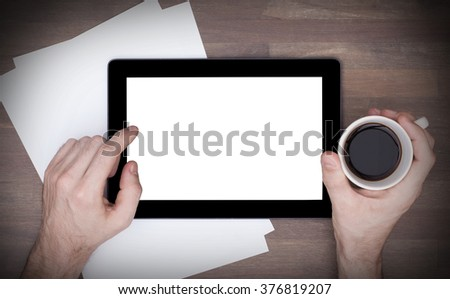 Tablet touch computer gadget on wooden table, vintage look