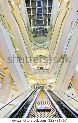 Taipei, Taiwan - September 13, 2015: Interior view of Taipei 101 mall with layers of escalators in Taipei on September 13, 2015.