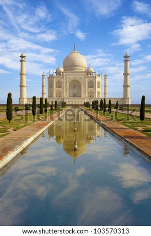 Taj Mahal at sunrise, reflecting in the pond. India.