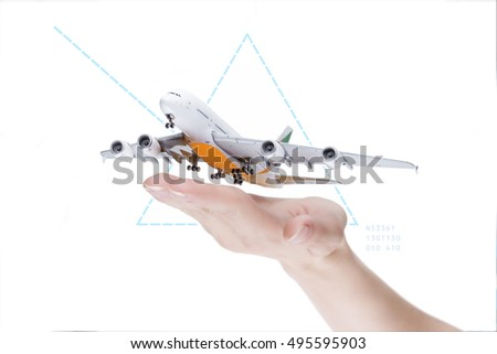 Take-off plain, transportation concept. Close up hand with airplane model