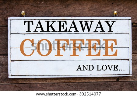 Takeaway Coffee and Love Here Inspirational message written on vintage wooden board. Motivation concept image