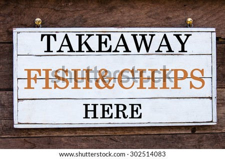 Takeaway Fish&Chips Here Inspirational message written on vintage wooden board. Motivation concept image