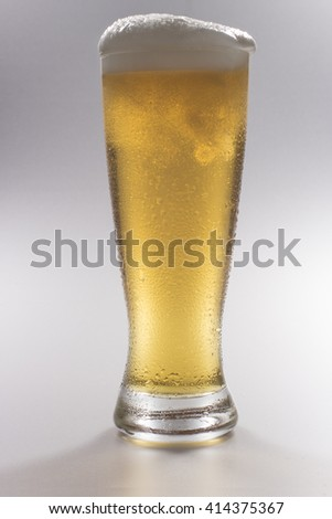 Tall Glass of Chilled Frothy Beer