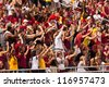 TALLAHASSEE, FL - OCT. 27:  FSU Seminole fans celebrate a touchdown by doing the Seminole Chop, a repetitive chopping motion to symbolize a tomahawk swinging down, in Tallahassee on Oct. 27, 2012. - stock photo