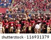 TALLAHASSEE, FL - OCT. 27:  Seminole players hold helmets high as Chief Osceola prepares to throw the spear to start the FSU vs Duke football game, at Doak Campbell Stadium on Oct. 27, 2012. - stock photo