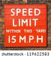 Tangerine speed limit sign on brick background - stock photo
