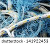 tangled ropes and fishing nets - stock photo