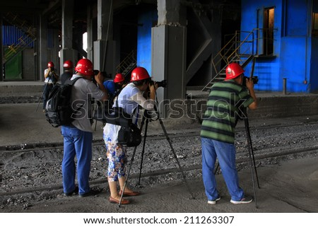 TANGSHAN - JUNE 19: cameramen were filming in a production workshop of iron and steel co., on June 19, 2014, Tangshan city, Hebei Province, China