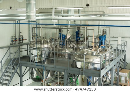 Tanks for chemical mixing on chemical plant. Concept: Manufacturing