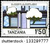 "TANZANIA - CIRCA 1985: A stamp printed in Tanzania shows Textile Industry, with the same inscription, from the series ""5th Anniversary of Southern Africa Development Coordination"", circa 1985 - stock photo"