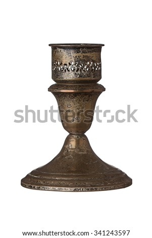 Tarnished antique candlestick holder isolated on a white background.