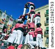 TARRAGONA, SPAIN - SEP 16: Castells on Sep 16, 2012 in Tarragona, Spain. Every year, during Santa Tecla festival, those typical catalan human towers are performed in Plaza de la Font - stock photo