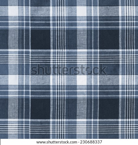 Tartan plaid blue natural cotton fabric. Seamless tiles texture for the background