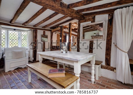 Tastefully Modernised And Decorated Dining Room Within 16th Century English Cottage Containing Color Washed Table