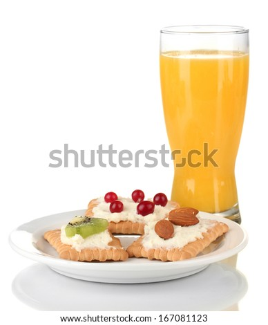 Tasty canapes with cheese, kiwi and cranberry, almond, on color plate, isolated on white