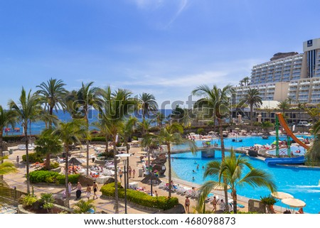 TAURITO, GRAN CANARIA, SPAIN - APRIL 23, 2016: Tourists on sun holidays at the Lago Taurito aquapark in Taurito, Gran Canaria. Taurito is very popular tourist destination