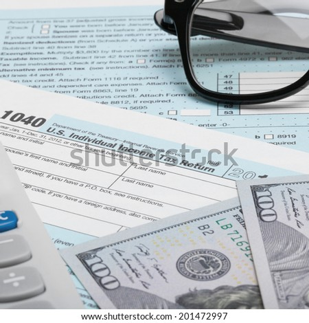 Usa tax form 1040 glasses 100 stock photo 207055546 for 1040 tax table calculator