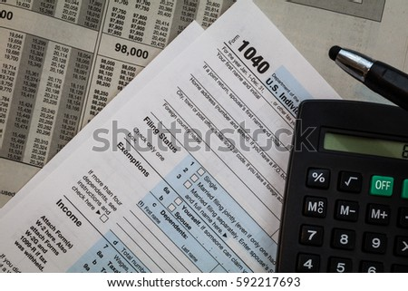 Tax preparation forms pen calculator on stock photo for 1040 tax table calculator