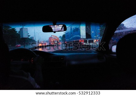 Taxi driving by night