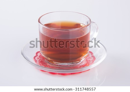 Tea in glass cup or glass cup of black tea on a background