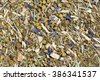 Tea mix of chamomile, thyme, cornflowers, mate, lemongrass and ginger. - stock photo