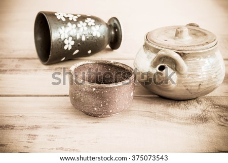 tea pot and cups on wooden table, Vintage Style.