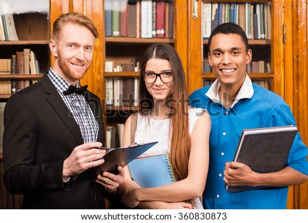 Teacher and students in library