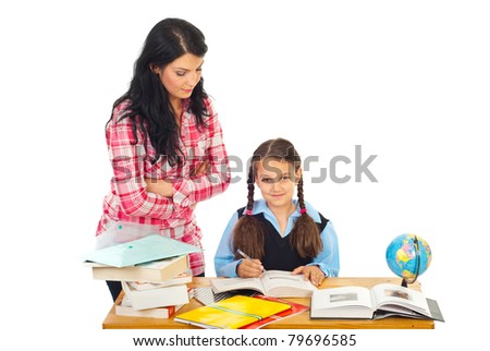 Teacher woman verify schoolgirl homework in a classroom against white background
