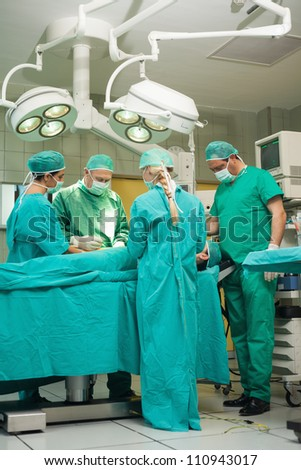Team of surgeon working on a patient in a surgical room