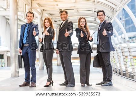 Team work of asia business people stand on street in city