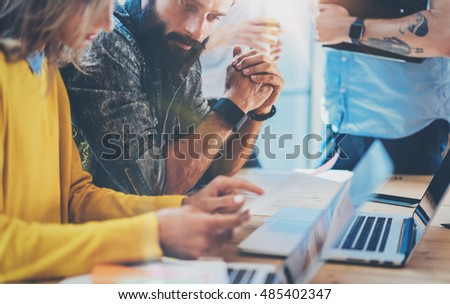 Teamwork Concept.Coworkers Team Brainstorming During Work Process Modern Loft Office.New Business Startup Project.Woman Discussing Market Report Colleagues.Young People Working Laptop Wood Table Desk