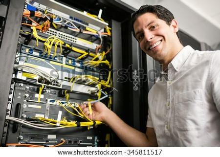 Technician looking at open server locker at the data centre