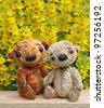 Teddy bears on a board among flowers. Handmade, the sewed plush toys - stock photo