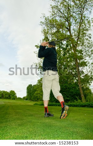 Teeing swing from backside