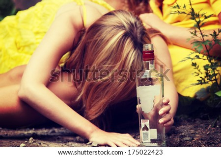 Teen alcohol addiction (drunk teens with vodka bottle)