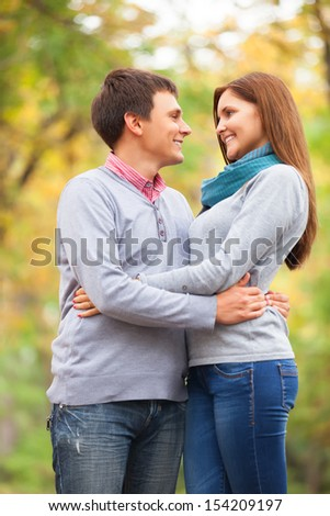 Teen couple at autumn park