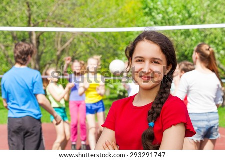 Teen girl at volleyball game on the playground