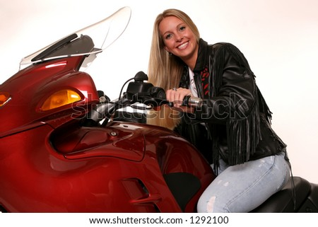 teen on red motorcycle